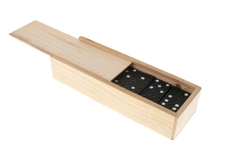 Domino in wooden box isolated on white background. photo