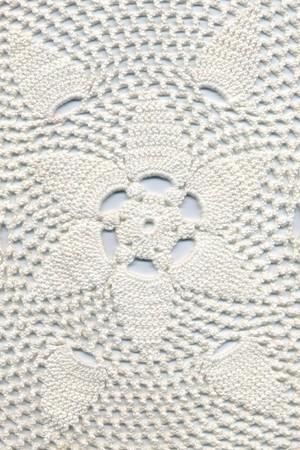 Hand made crocheted doily. photo