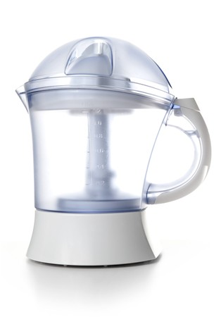 Modern juice extractor isolated on a white background. photo