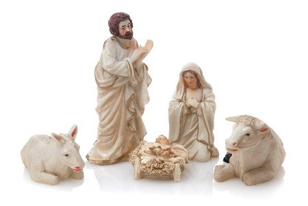 figurines: Ceramic nativity scene isolated on white background. Stock Photo