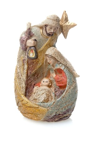 religious event: Christmas crib isolated on white statuettes representing Mary, Jesus and Joseph.