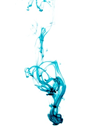 Blue ink splash flowing in water isolated on white background. photo