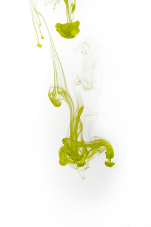 Green ink splash flowing in water isolated on white background. photo
