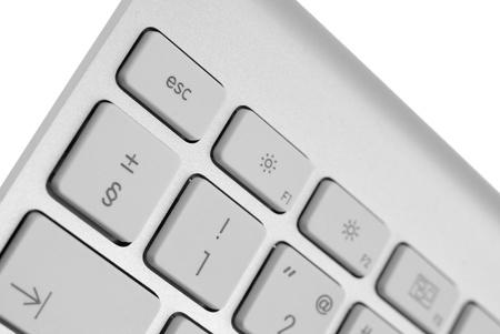 escape key: Closeup of a modern aluminium keyboard, focus on the Escape key.