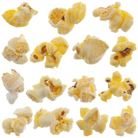 Popped kernels of pop corn snack isolated on white background.