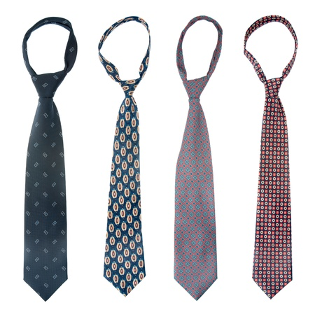 ironed: Four ties isolated on white background. Stock Photo