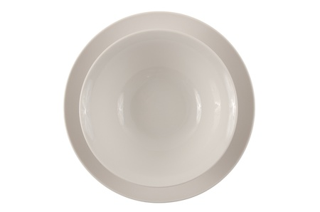 Round white plate and bowl isolated on white background. photo