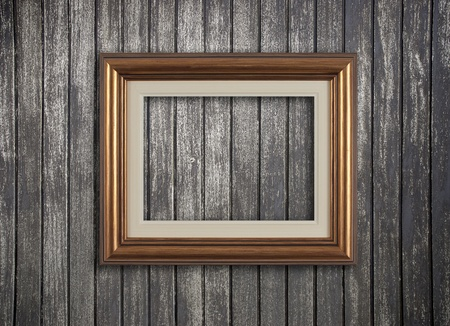 Vintage wooden frame on a wood made wall. Stock Photo - 9901469
