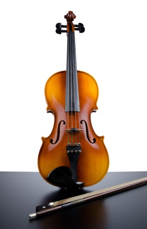 violas: Violin on top of dark table partially isolated on white background. Stock Photo