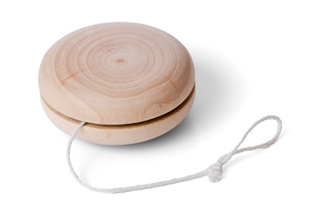 Wooden yo-yo toy isolated on white background. photo