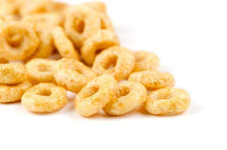 Round yellow cereals isolated on white background.