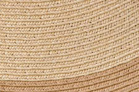 Curved lines pattern in a Straw Basket background. photo