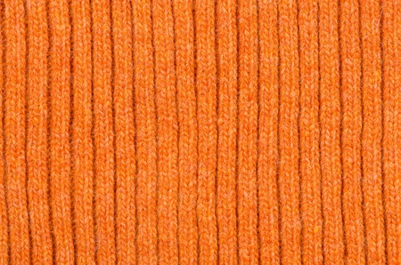 ravel: Background from the connected orange woolen cloth.