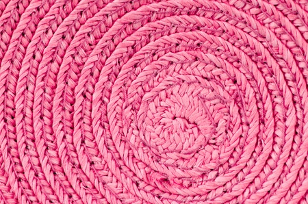 Circular background from pink rattan fibers. photo