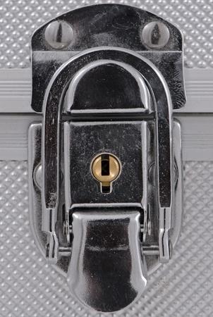Shiny metal case lock closeup. photo