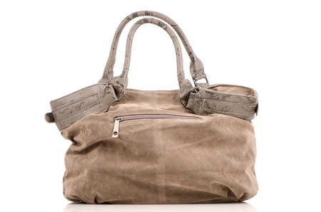 Brown woman bag on white reflective background. Stock Photo - 10555144