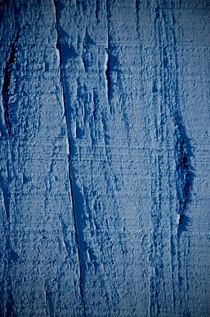 Blue flaky paint on a wood background. photo