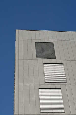 Modern building with metal facade on a blue sky. photo
