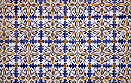 Colorful vintage spanish style ceramic tiles wall decoration. photo