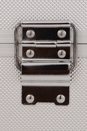 Shiny metal case lock closeup. Stock Photo - 11159450