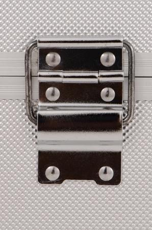 Shiny metal case lock closeup. Stock Photo - 11159450