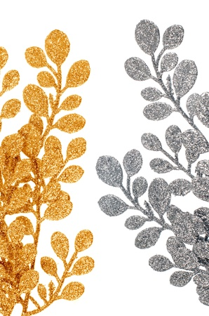 Chistmas decorative golden and silver leaves isolated on white background. photo