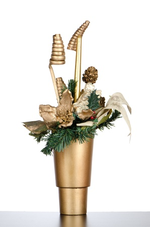 Christmas candle decorations on a golden vase. Stock Photo - 11325998