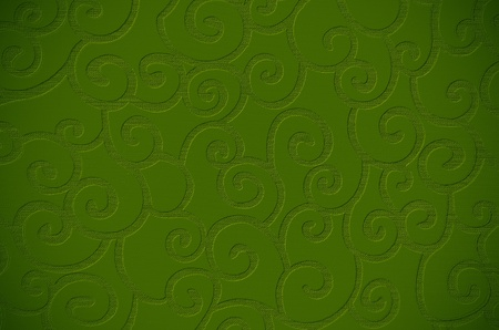 embossed: Elegant decorative green textured surface close up.