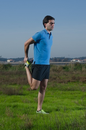 Male runner exercising outdoors on country landscape. Stock Photo - 11820034