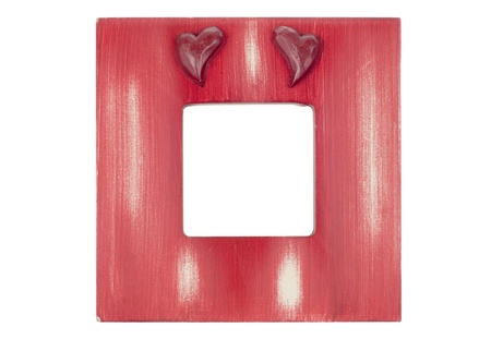 Red wooden picture frame with hearts isolated on white background. Stock Photo