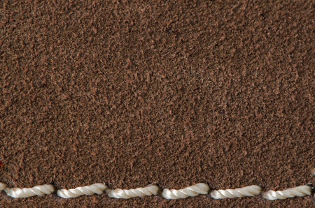 leather stitch: Brown leather with seam, stitch background. Stock Photo