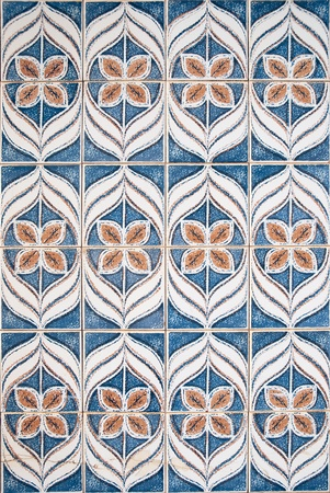 Blue and brown pattern made of ceramic tiles. photo