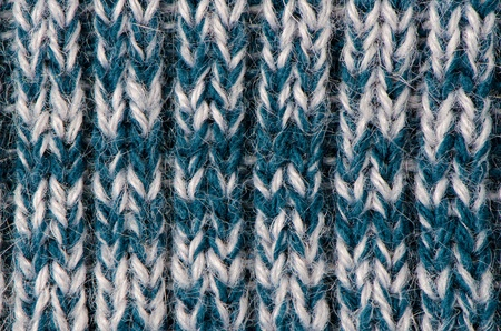 Knit woolen texture. Fabric blue and white background. Stock Photo - 12192679
