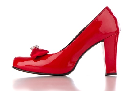 Red high heel women shoe on white reflective background. Stock Photo - 12192673