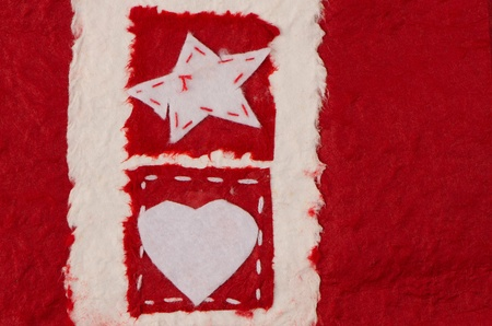 Ripped pieces of paper on recycled paper background. Heart and Star forms. Valentines Day photo
