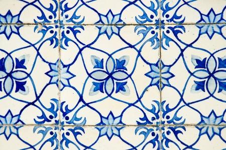 Portuguese azulejos, old tiled blue background. photo