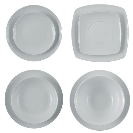 Set of empty white plates on white background. photo
