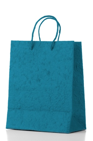 Blue  paper bag over white background. photo