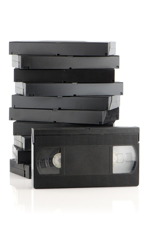 Pile of videotapes on  white reflective background. photo