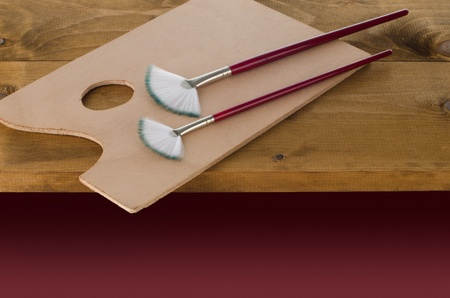 pallete: Painting brushes and art pallete on wooden board. Stock Photo