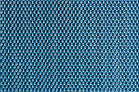 Blue  metal mesh plating isolated against a white background photo
