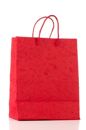 Red  paper bag over white background  photo
