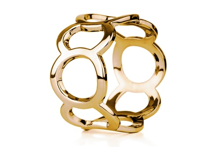 Gold bracelet isolated on white a background. Stock Photo