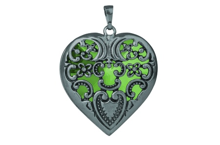 Lovely pendent in the shape of a heart isoalted on white background. Stock Photo
