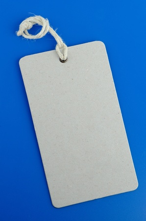 Blank product info label on blue background  photo