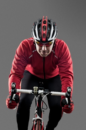 Cyclist on road bike on grey background. Stock Photo - 13078269