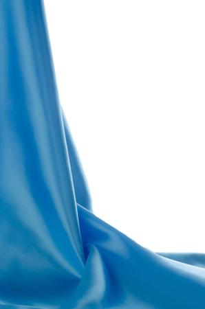 Blue satin isolated on white background. photo