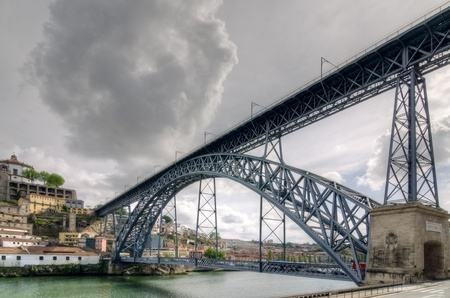 Famous steel bridge Ponte dom Luis above connects Old town Porto with Vila Nova de Gaia at river Duoro, Portugal Stock Photo - 13405107
