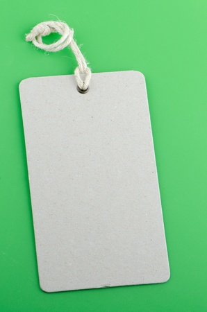 Blank product info label on green background. photo