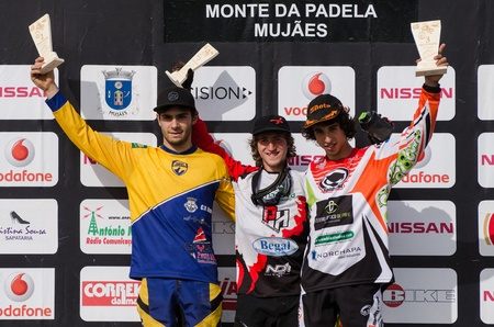 VIANA DO CASTELO, PORTUGAL - MAY 13: Junior winner Joao Gois in the middle at the podium on the 4th Stage of the Taca de Portugal Downhill Vodafone on may 13, 2012 in Viana do Castelo, Portugal. Stock Photo - 13652291